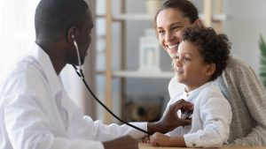 Doctor Checking Young Patient